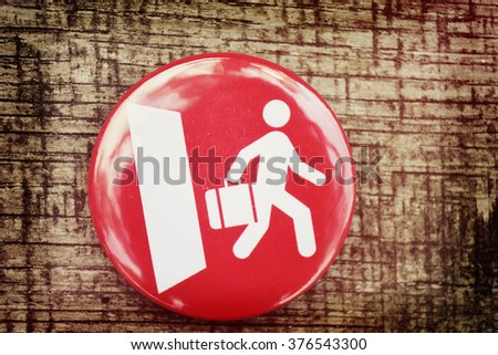 red icon and a white man walks out the door - stock photo