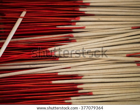 red incense sticks in buddhist temple - stock photo