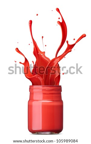 red ink splashing out from its bottle - stock photo