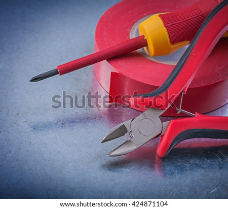 Red insulating tape nippers insulated turnscrew construction concept.