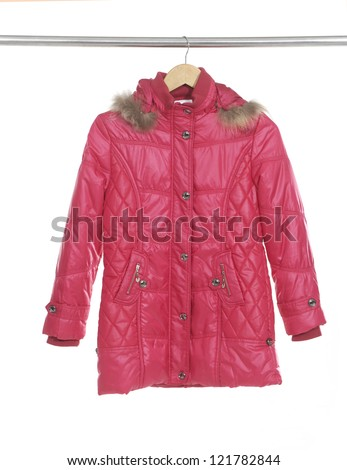 red jacket hanging on coat hanger - stock photo