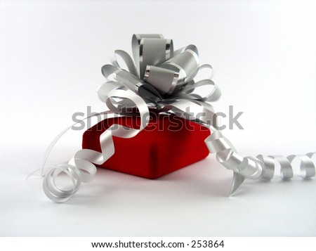 red jewelry case with silver ribbon