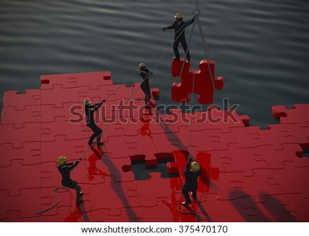 Red Jigsaw puzzle being built by teamwork at dawn by the ocean. A great red jigsaw puzzle being built by a successful team  at dawn by the ocean. - stock photo