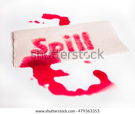 Red juice spill with word and paper towel on white surface