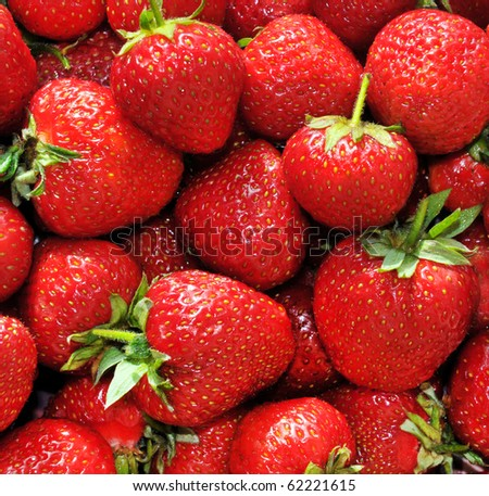 Red juicy strawberries closeup, background