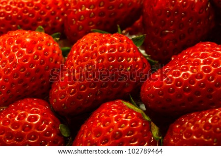 Red juicy wet strawberries closeup, background - stock photo