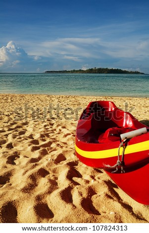 Red kayak on the sandy beach