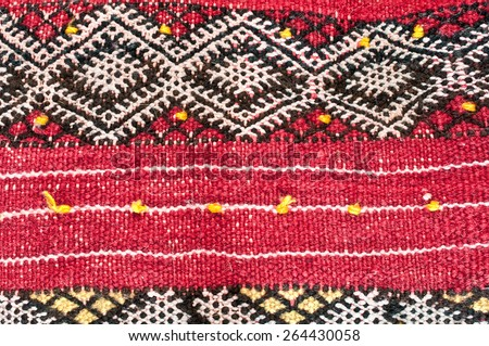 Red kilim textile material as a background image - stock photo