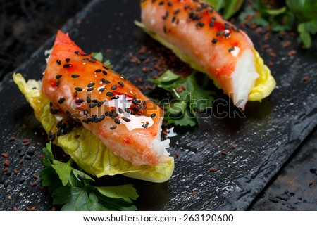 Red king crab, lettuce, parsley, sweet chili, black sesame seeds and azalea seeds appetizer - selective focus - stock photo