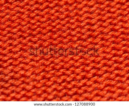red knitted fabric as background - stock photo