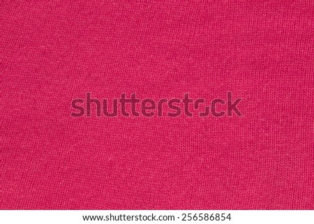 Red knitted wool fabric background - stock photo