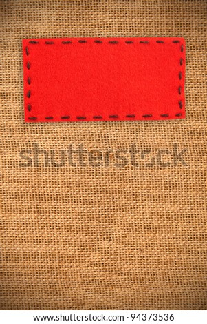 red label on burlap texture - stock photo