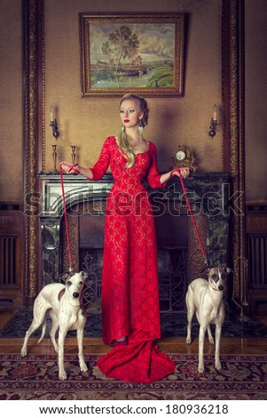 red Lady with two whippets - stock photo
