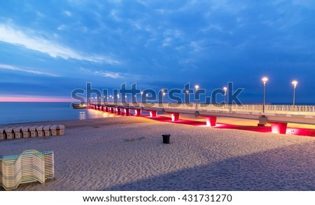 Red lamps on the pier in the evening, Poland - stock photo