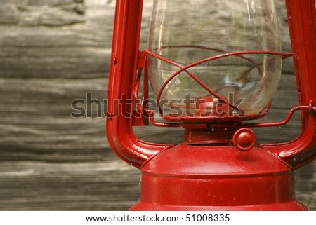 Red Lantern Against Wooden Wall - stock photo
