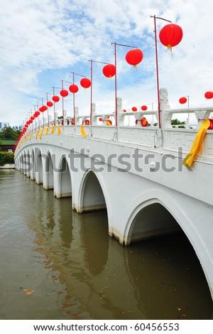 Red Lanterns Decorating A White Arch Bridge - stock photo