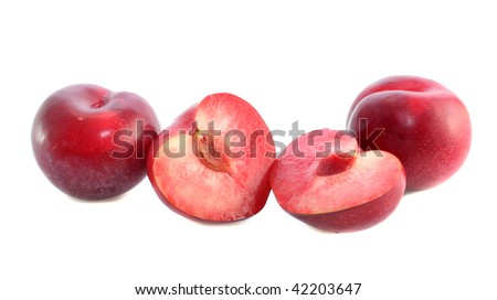 Red large plum on a white background, it is isolated.