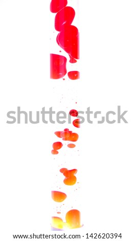 Red lava lamp. Studio shot, isolated on white background - stock photo