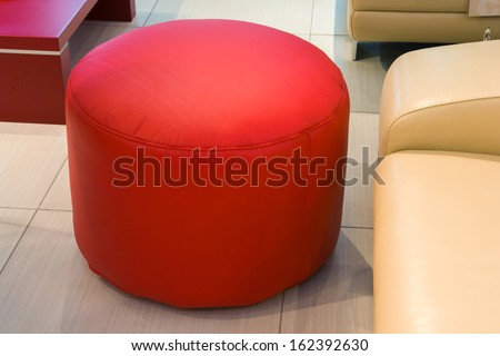 Red leather foot stool ottoman  - stock photo