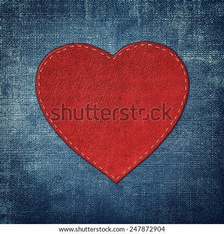 red leather heart on fabric in grunge style - stock photo
