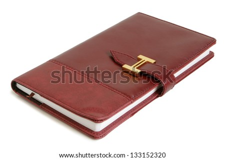 Red leather notebook on a white background - stock photo