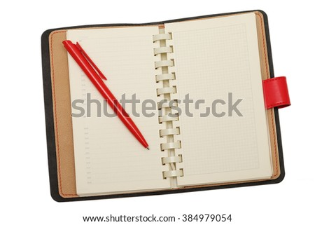 red leather notebook with pen on a white background - stock photo