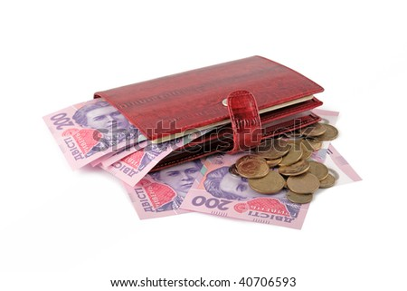 Red leather purse with money: ukrainian banknotes. Two hundred hryvna and coins. Isolated on white background.