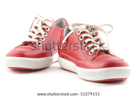 red leather sneakers on white
