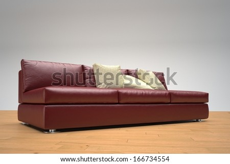 Red leather sofa on wooden floor and white background