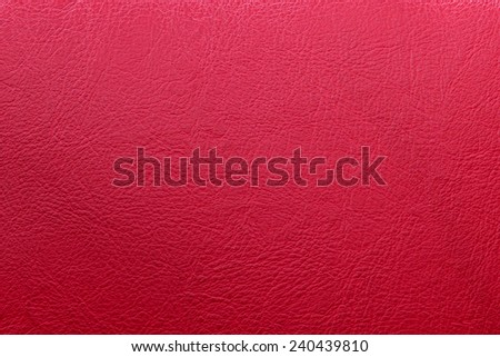 Red leather sofa texture background - stock photo