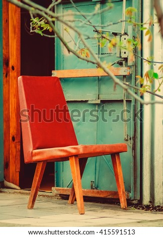 Red Leather-Substitute Chair next to the Steel Door,Country Cottage Vacation,Holidays,Country Village,Toned