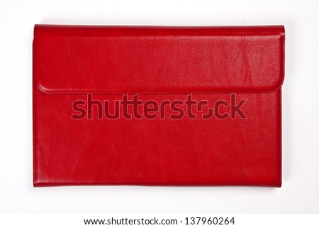 Red leather tablet computer bag on a white background - stock photo