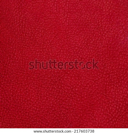 Red leather texture background. - stock photo