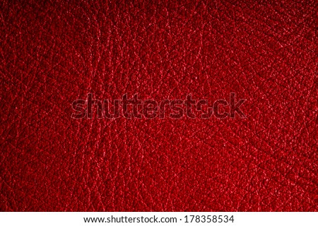 Red leather texture closeup grunge background. Country western background, cowboy rawhide design, abstract pattern - stock photo