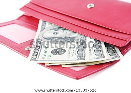 red leather wallet closeup with money isolated on white background