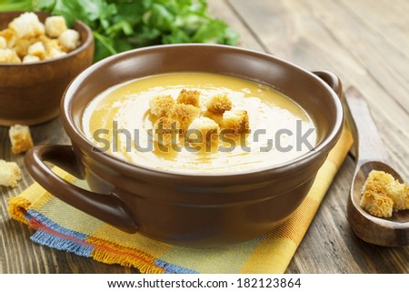 Red lentil soup with croutons in the bowl - stock photo