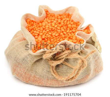 red lentils in the sack isolated on white - stock photo