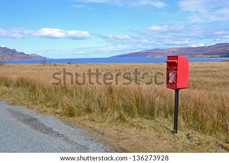 Red letterbox on the Isle of Skye, Scotland - stock photo