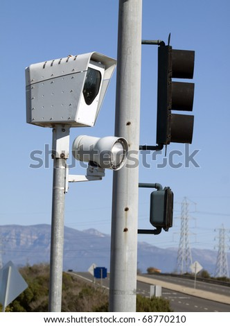 Red light camera aimed at dangerous intersection - stock photo