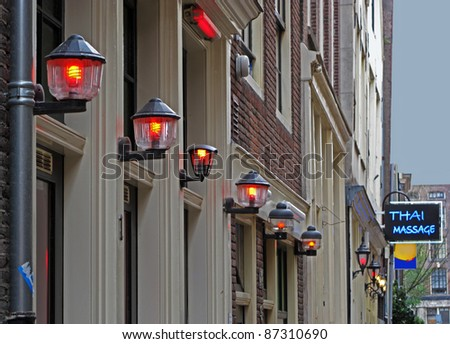 Red light district by dusk in Amsterdam, Netherlands, European union. - stock photo