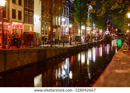 Red-light district in Amsterdam on October 10 2016 in Amsterdam, Netherlands. There are about three hundred cabins rented by prostitutes in the area.