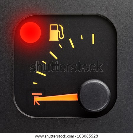 Red light - empty tank pointer - stock photo
