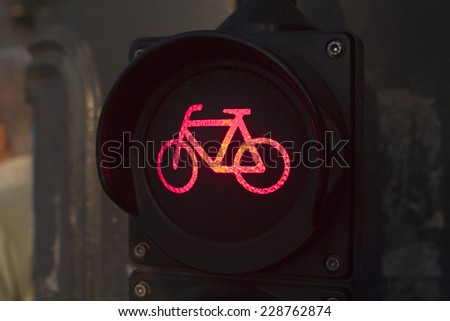 Red light for bicycle lane on a traffic light. Bicycle sign in the city - stock photo