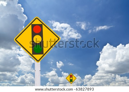 red light warning sign on blue sky - stock photo