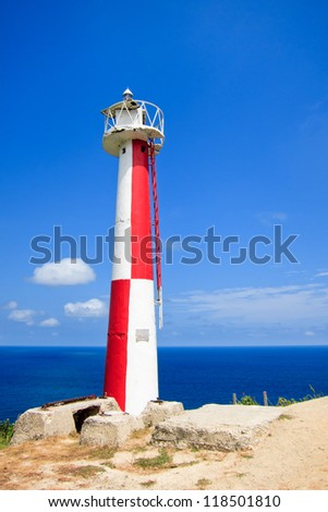 Red lighthouse - stock photo