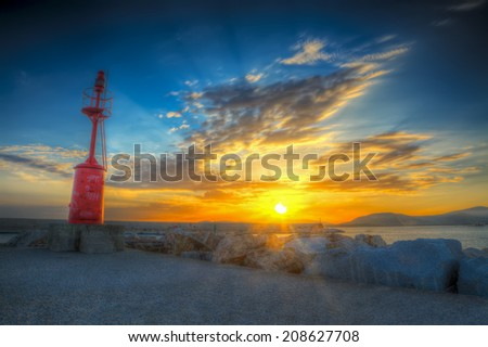 red lighthouse at sunset. hdr. - stock photo