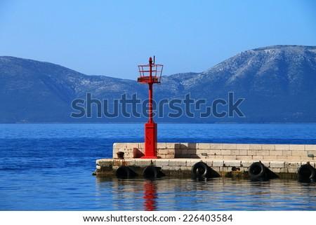 Red lighthouse in Gradac , Croatia - stock photo