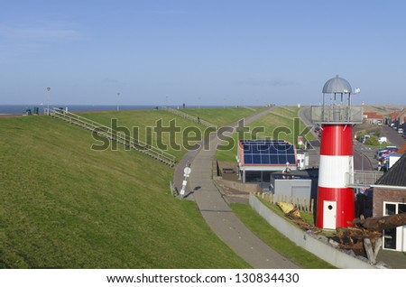 red lighthouse in Westkapelle, Netherlands, seen from the sea dyke - stock photo
