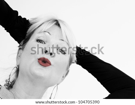 Red lips and black gloves, a black and white image - stock photo