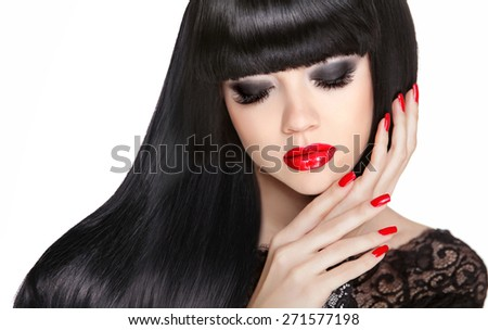 Red lips and manicured nails. Brunette girl model with long black hairstyle isolated on white background.  - stock photo